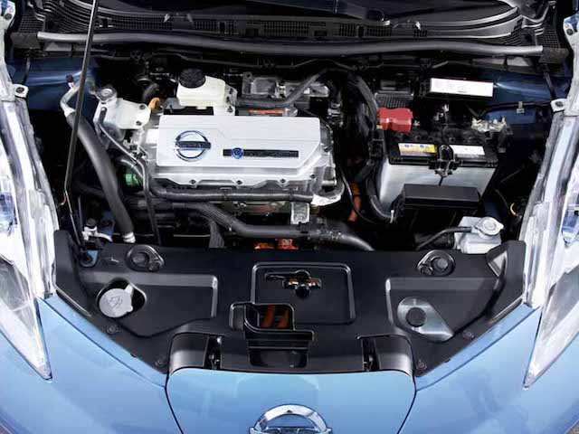Generation 1 Engine Bay Showing Charger Cover (grey Metal Rectangle With  Nissan Logo On It).